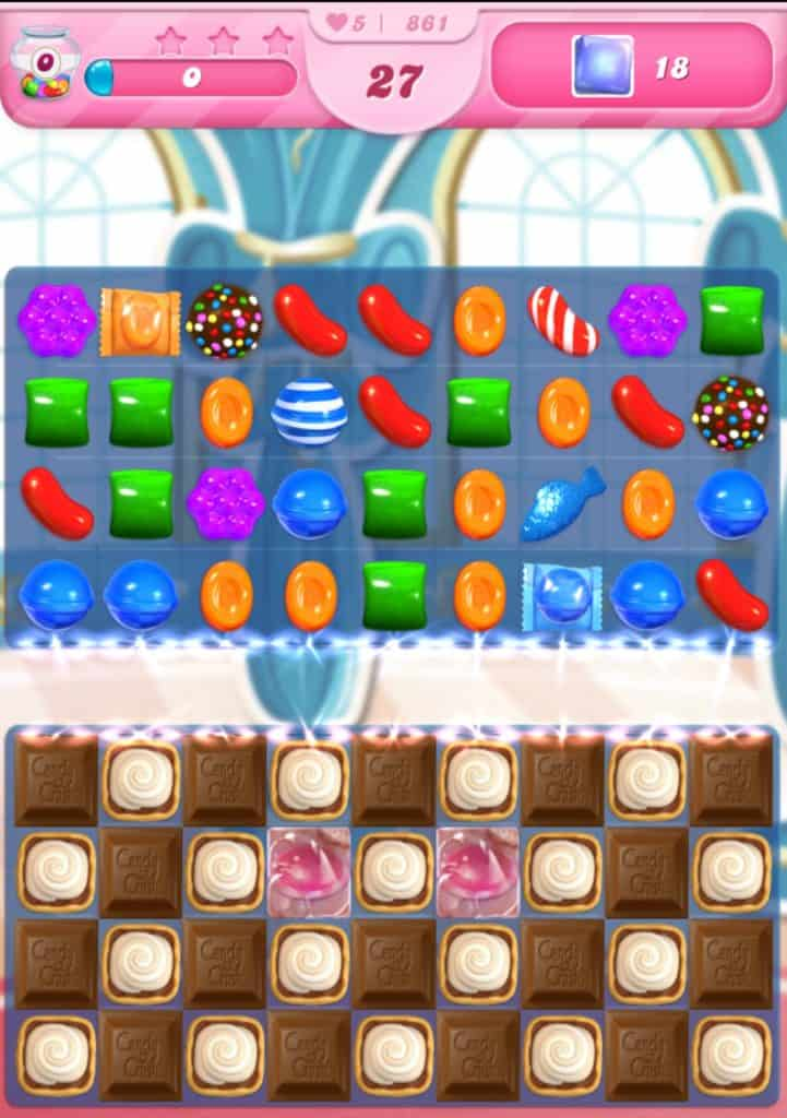 A Candy Crush Saga level. This level has chocolate and multiple powerups.